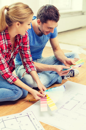 Couples selecting colours as part of the process of building a house