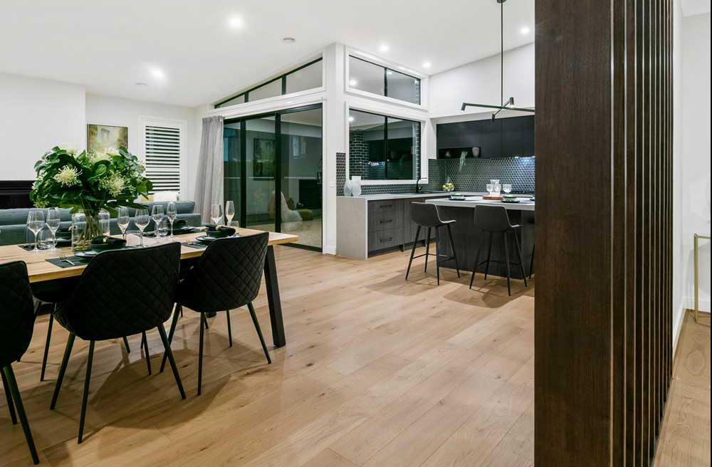 The dining area flowing on from the kitchen, showing luxuriously appointed home inclusions